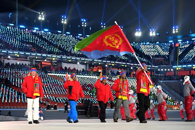 <p>Flag bearer Shannon-Ogbani Abeda of Eritrea and teammates arrive at the stadium during the Opening Ceremony of the PyeongChang 2018 Winter Olympic Games at PyeongChang Olympic Stadium on February 9, 2018 in Pyeongchang-gun, South Korea. (Photo by Matthias Hangst/Getty Images) </p>