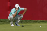 Alex Noren of Sweden eyes his putt on the 18th green during the final round of the Rocket Mortgage Classic golf tournament, Sunday, July 4, 2021, at the Detroit Golf Club in Detroit. (AP Photo/Carlos Osorio)