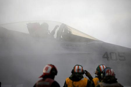 "A U.S. F18 fighter jet prepares for take off from the deck of U.S. aircraft carrier USS Carl Vinson during an annual joint military exercise called ""Foal Eagle"" between South Korea and U.S., in the East Sea"