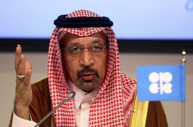 FILE - In this June 23, 2018 file photo, Saudi Energy Minister Khalid al-Falih attends a news conference in Vienna, Austria. Saudi Arabia's renewed push to publicly list its most valuable entity, Aramco, is part of a high-stakes masterplan by Crown Prince Mohammed bin Salman. In a step toward a potential initial public offering, the state-owned company this week moved to distance itself from the government by replacing al-Falih as board chairman with the finance-minded Yasir al-Rumayyan, who heads the Public Investment Fund (PIF), the country's sovereign wealth fund. (AP Photo/Ronald Zak, File)
