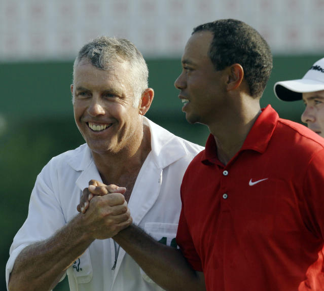 <p>Tiger Woods is congratulated by caddie Steve Williams after his the final round of the Masters golf tournament Sunday, April 10, 2011, in Augusta, Ga. (AP Photo/David J. Phillip) </p>