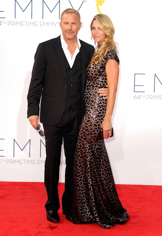 "Kevin Coster and Christine Baumgartner Grade: A Kevin Costner – in shades and a three-piece suit – and wife Christine Baumgartner made one cool couple at the big event on Sunday night. When they finally made it into the Nokia Theatre, Costner was presented with the statue for lead actor in a miniseries or movie for his role in the breakout hit ""Hatfields & McCoys."""