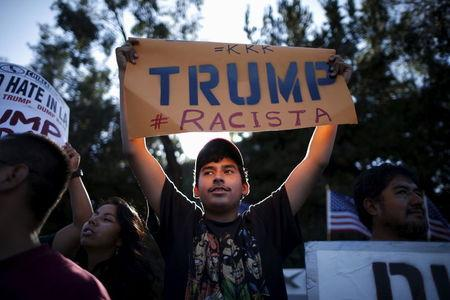 People protest outside the Luxe Hotel, where Republican presidential candidate Donald Trump was expected to speak in Brentwood, Los Angeles