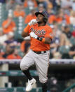Baltimore Orioles' Maikel Franco rounds the bases after a solo home run during the fifth inning of a baseball game against the Detroit Tigers, Saturday, July 31, 2021, in Detroit. (AP Photo/Carlos Osorio)