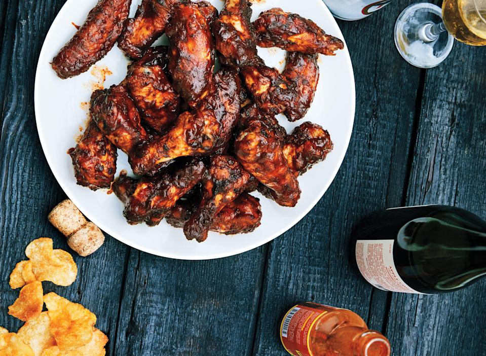 "Start the meal right with these smoky wings, laced with chili powder, garlic powder, onion powder, chipotle powder, and mustard powder for great flavor. <a href=""https://www.epicurious.com/recipes/food/views/smoked-chicken-wings?mbid=synd_yahoo_rss"" rel=""nofollow noopener"" target=""_blank"" data-ylk=""slk:See recipe."" class=""link rapid-noclick-resp"">See recipe.</a>"