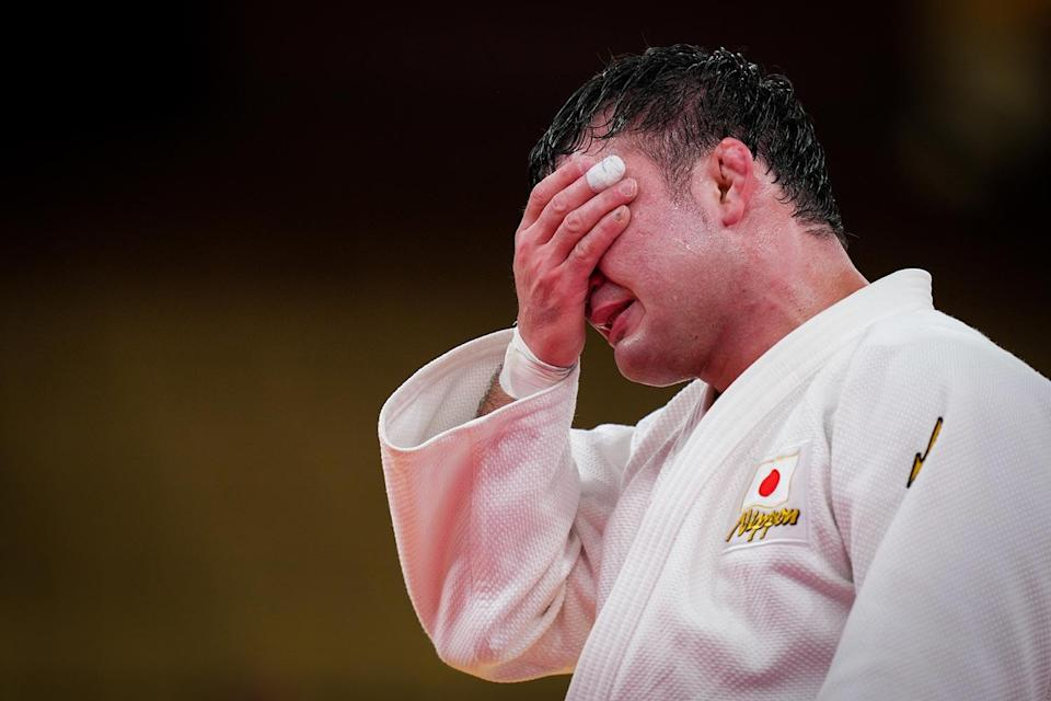 <p>Team Japan's Aaron Wolf gets emotional after winning gold at the Men -100 kg Final at the Nippon Budokan on July 29.</p>