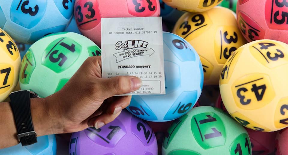A man holds a Set For Life ticket with lottery balls in the background.
