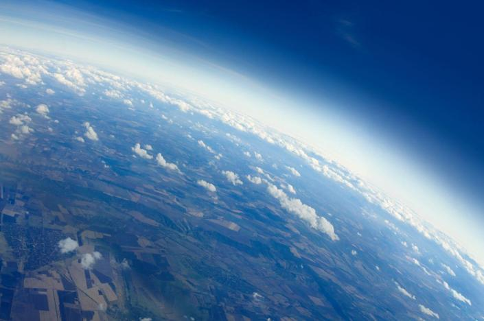 <p>Planet Earth is shaped more like a oblate spheroid which looks like a flatter circle. But it's <em>definitely</em> not flat. <br></p>