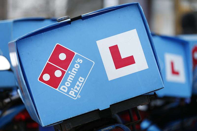 Stock photo of Domino's Pizza delivery a motorcycles. (Photo by Jonathan Brady/PA Images via Getty Images)