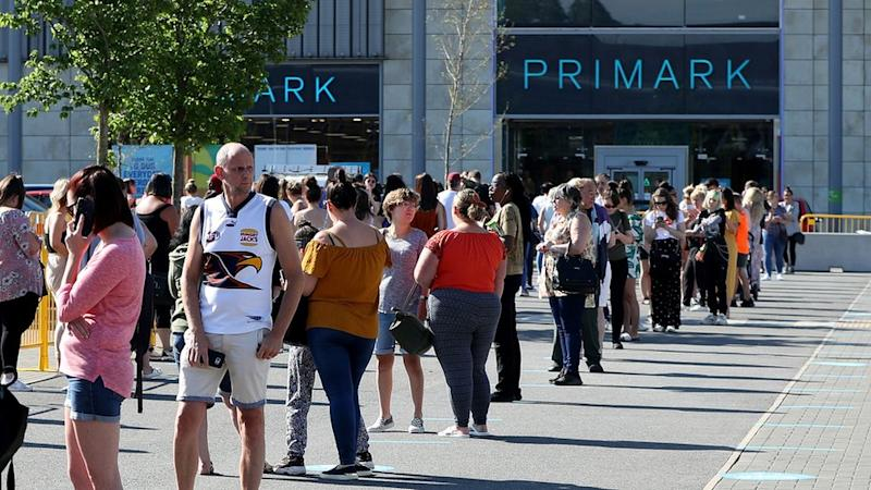 Shoppers queued outside Primark when it reopened on 15 June