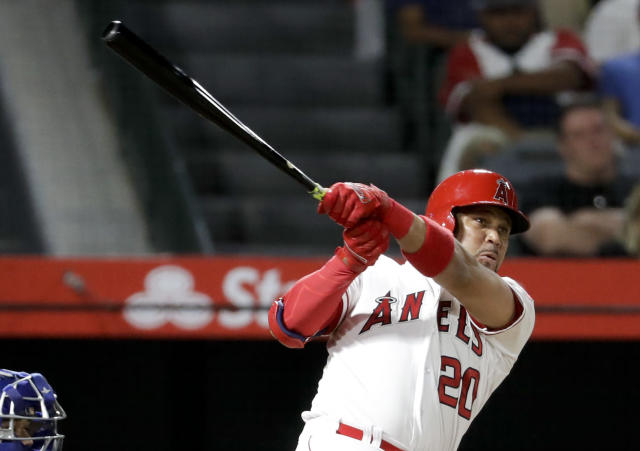Los Angeles Angels' Jose Fernandez watches his home run against the Texas Rangers during the second inning of a baseball game in Anaheim, Calif., Tuesday, Sept. 11, 2018. (AP Photo/Chris Carlson)