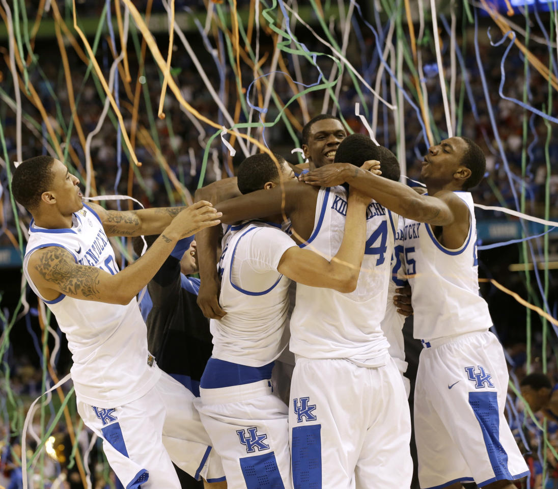 Kentucky players celebrate at the end of the NCAA Final Four tournament college basketball championship game against Kansas Monday, April 2, 2012, in New Orleans. Kentucky won 67-59. (AP Photo/David J. Phillip)