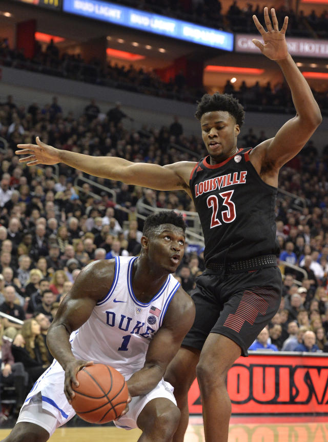 Duke forward Zion Williamson (1) looks to shoot as Louisville center Steven Enoch (23) defends during the first half of an NCAA college basketball game in Louisville, Ky., Tuesday, Feb. 12, 2019. (AP Photo/Timothy D. Easley)