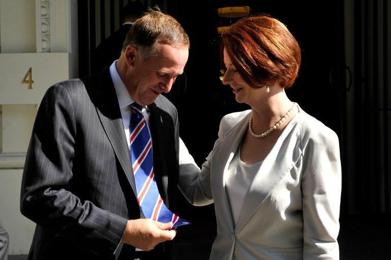 New Zealand's PM, John Key, shows his tie to Australia's PM Julia Gillard, in Melbourne, on January 29, 2012
