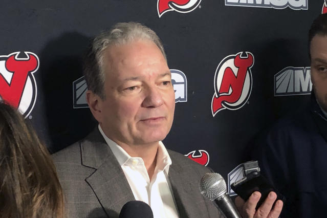 New Jersey Devils NHL hockey team general manager Ray Shero talks with the media after practice in Newark, N.J., Tuesday, Dec. 17, 2019. The Arizona Coyotes acquired standout winger Taylor Hall from the New Jersey Devils on Monday for three prospects and two draft picks. New Jersey was looking to re-sign Hall to a long-term contract. (AP Photo/Tom Canavan)