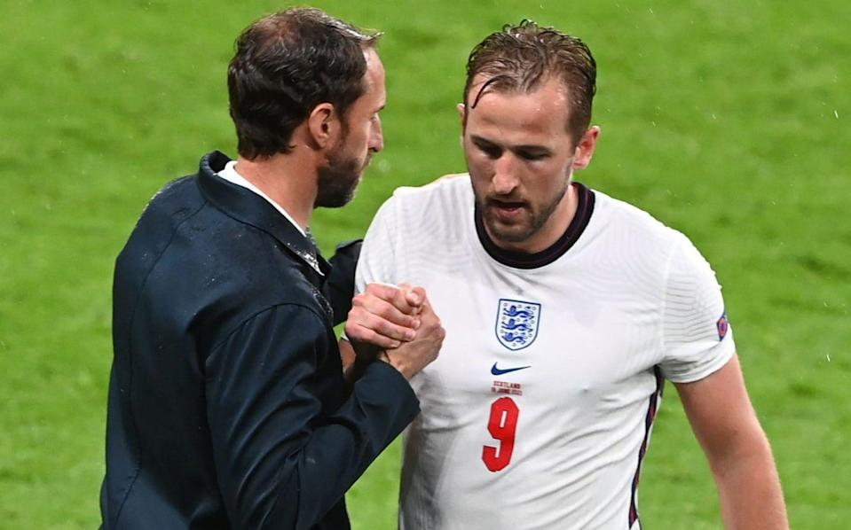 Harry Kane (R) of England interacts with England manager Gareth Southgate after being substituted during the UEFA EURO 2020 group D preliminary round soccer match between England and Scotland - Facundo Arrizabalaga/POOL/EPA-EFE/Shutterstock