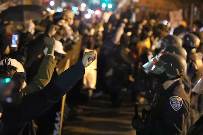 Protesters face off with a line of police in Rochester, N.Y., on  Feb. 23 after an announcement by the state attorney general that a grand jury would not bring criminal charges against any of the police officers involved in Daniel Prude's detainment in 2020.