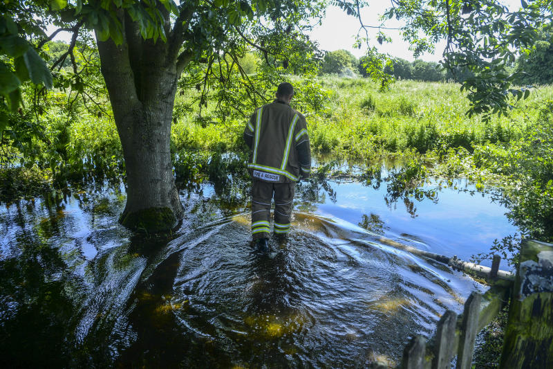 The Lincolnshire fire service battling to pump water away from homes in Wainfleet