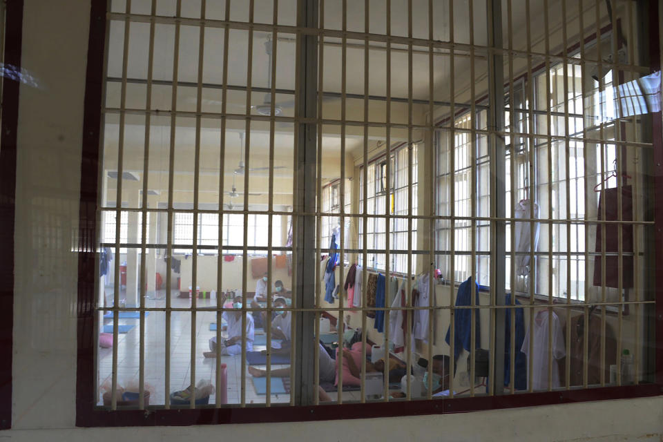 In this photo released by Department of Corrections, COVID-19 prisoners sit inside a field hospital set up at Medical Correctional Institution to treat COVID-19 inmates, in Bangkok, Thailand, on May 8, 2021. Almost 3,000 inmates incarcerated at two prisons in Thailand's capital Bangkok have tested positive for COVID-19, the Corrections Department said Wednesday, May 12, 2021 as the Southeast Asian nation battles a virulent third wave of the coronavirus. (Department of Corrections, Thailand via AP)