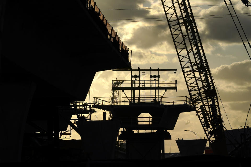 The new Signature Bridge is under construction in downtown Miami, Tuesday, April 27, 2021, just east of the Overtown neighborhood. The Signature Bridge project coincides with the revitalization of the neighborhood that is currently underway. (AP Photo/Lynne Sladky)