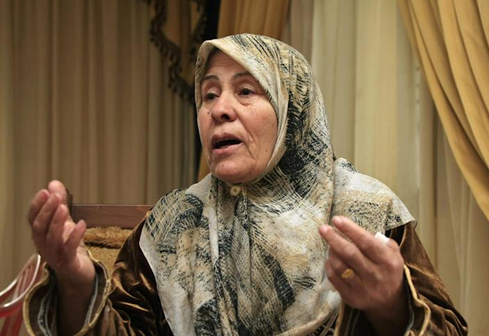 In this picture taken on Monday, Feb. 24, 2014, Nada Saleh Shintawi, the grandmother of suicide bomber Nidal al-Mughayar, speaks during an interview with The Associated Press at her home in the southern village of Bisariyeh, Lebanon. Nidal al-Mughayar renewed his travel document last year and told his family he will be leaving Lebanon to settle in Venezuela where there are more opportunities but it turned out later that the young Palestinian man called his family from Syria and it was only then that they knew he has joined jihadis fighting to overthrow President Bashar Assad's government. (AP Photo/Mohammed Zaatari)