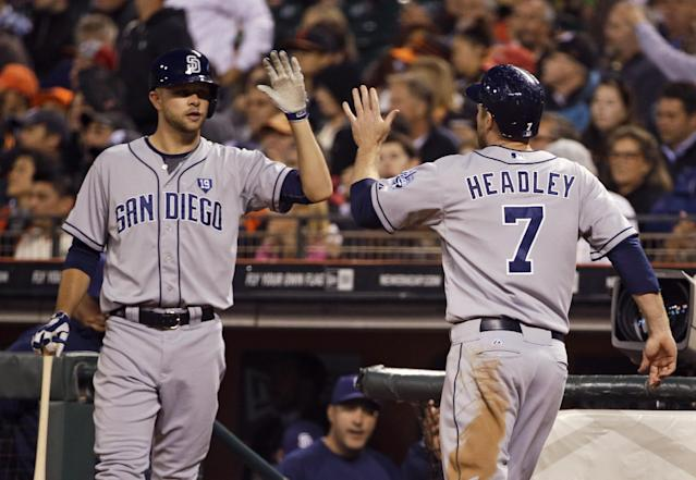 San Diego Padres' Chase Headley, right, is greeted by Jesse Hahn, left, after scoring in the sixth inning of a baseball game against the San Francisco Giants on Tuesday, June 24, 2014, in San Francisco. (AP Photo/Eric Risberg)