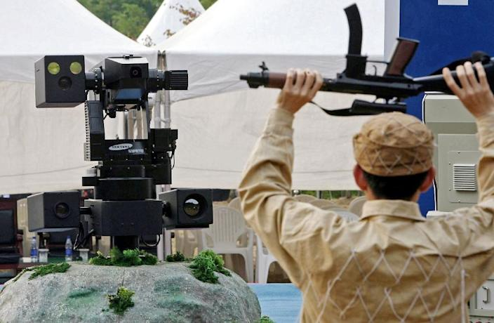 A sentry robot freezes a hypothetical intruder by pointing its machine gun during a 2006 test in Cheonan, South Korea (AFP Photo/Kim Dong-Joo)