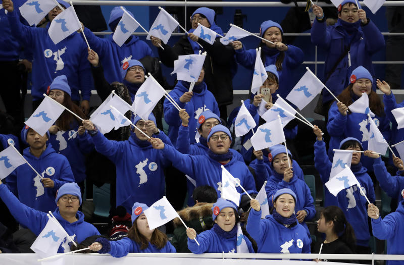 Korean supporters cheer after the preliminary round of the women's hockey game between Sweden and the combined Koreas at the 2018 Winter Olympics in Gangneung, South Korea, Monday, Feb. 12, 2018. Sweden won 8-1. (AP Photo/Julio Cortez)