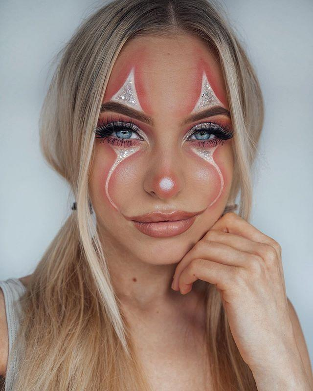 """<p>For this pretty clown look,<strong> you only need three things: <a href=""""https://www.amazon.com/stila-Magnificent-Glitter-Diamond-Multi-color/dp/B06VSXK4S4?tag=syn-yahoo-20&ascsubtag=%5Bartid%7C10049.g.33247158%5Bsrc%7Cyahoo-us"""" rel=""""nofollow noopener"""" target=""""_blank"""" data-ylk=""""slk:silver glitter"""" class=""""link rapid-noclick-resp"""">silver glitter</a>, <a href=""""https://go.redirectingat.com?id=74968X1596630&url=https%3A%2F%2Fwww.ulta.com%2Fbff-liquid-liner%3FproductId%3Dpimprod2009525&sref=https%3A%2F%2Fwww.cosmopolitan.com%2Fstyle-beauty%2Fbeauty%2Fg33247158%2Fcute-clown-halloween-makeup-tutorials%2F"""" rel=""""nofollow noopener"""" target=""""_blank"""" data-ylk=""""slk:white eyeliner"""" class=""""link rapid-noclick-resp"""">white eyeliner</a>, and <a href=""""https://go.redirectingat.com?id=74968X1596630&url=https%3A%2F%2Fwww.ulta.com%2Fcream-lip-cheek-pencil%3FproductId%3DxlsImpprod15581015&sref=https%3A%2F%2Fwww.cosmopolitan.com%2Fstyle-beauty%2Fbeauty%2Fg33247158%2Fcute-clown-halloween-makeup-tutorials%2F"""" rel=""""nofollow noopener"""" target=""""_blank"""" data-ylk=""""slk:peach lip and cheek pencil"""" class=""""link rapid-noclick-resp"""">peach lip and cheek pencil</a>.</strong> Start by drawing the points above your brows and below your eyes with the white eyeliner. Then, use the peach pencil to fill in your lips and trace around the white shapes, and blend out the lines with your finger. Finish with the <a href=""""https://www.cosmopolitan.com/style-beauty/beauty/g28351334/best-glitter-eyeshadow/"""" rel=""""nofollow noopener"""" target=""""_blank"""" data-ylk=""""slk:glitter eyeshadow"""" class=""""link rapid-noclick-resp"""">glitter eyeshadow</a> inside the white shapes.</p><p><a href=""""https://www.instagram.com/p/B4LC7Swn3ND/?utm_source=ig_embed&utm_campaign=loading"""" rel=""""nofollow noopener"""" target=""""_blank"""" data-ylk=""""slk:See the original post on Instagram"""" class=""""link rapid-noclick-resp"""">See the original post on Instagram</a></p>"""