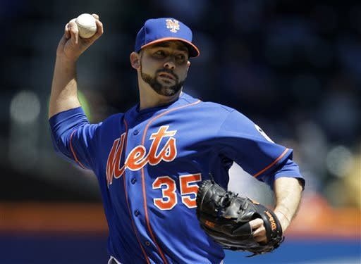 New York Mets starting pitcher Dillon Gee winds up in the first inning of a baseball game against the Washington Nationals at Citi Field in New York, Sunday, April 21, 2013. The Mets shut out the Nationals 2-0. (AP Photo/Kathy Willens)