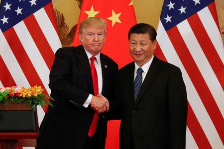 FILE PHOTO: U.S. President Donald Trump and China's President Xi Jinping shake hands after making joint statements at the Great Hall of the People in Beijing