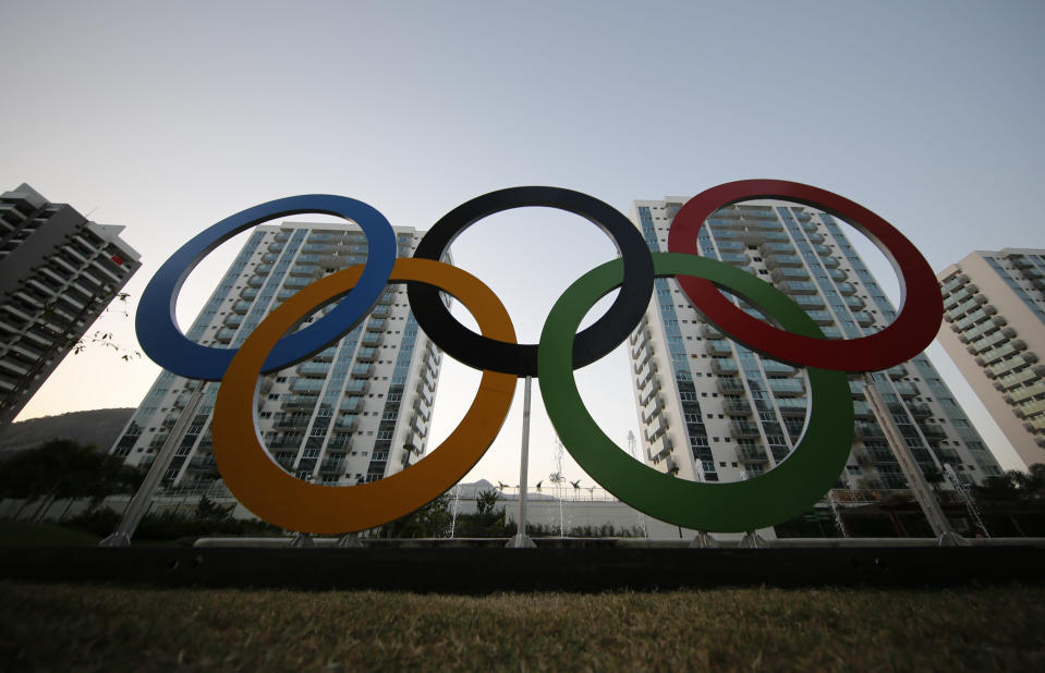 FILE - In this July 23, 2016, file photo, a representation of the Olympic rings are displayed in the Olympic Village in Rio de Janeiro, Brazil. The U.S. Olympic and Paralympic Committee will add athletes to its board and enhance its oversight of individual sports organizations. Its part of a package of reforms stemming from the Larry Nassar sex-abuse scandal. The reforms were approved Thursday, Nov. 8, 2019 and go into effect in January. (AP Photo/Leo Correa, File)