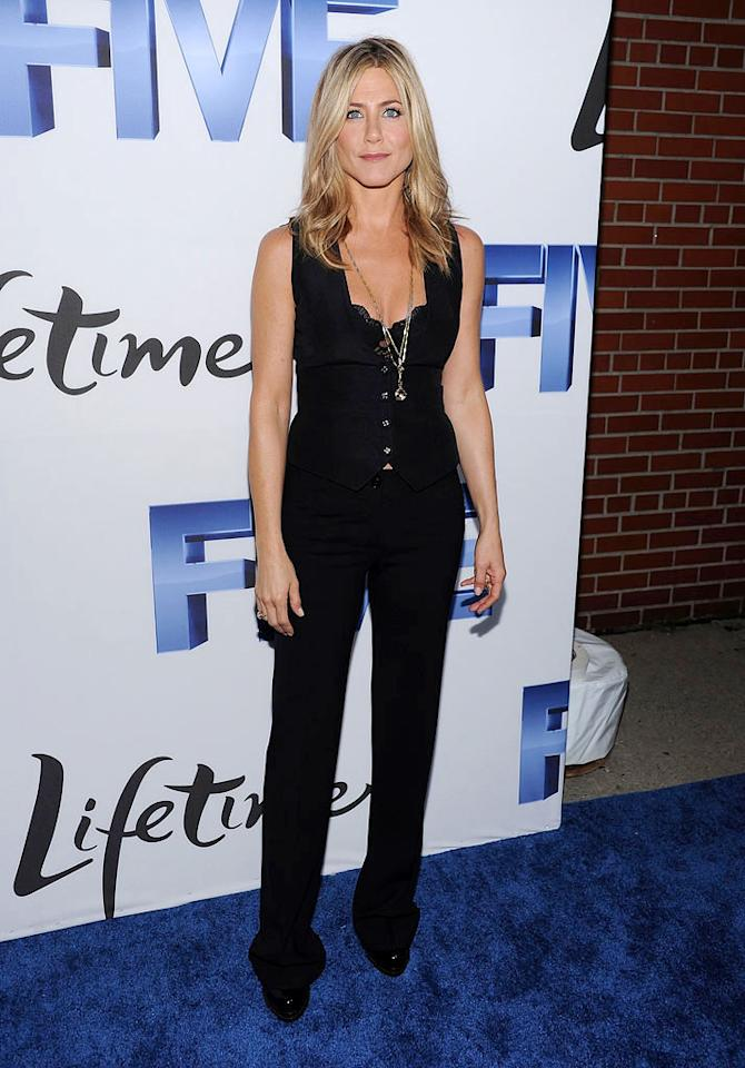 "Following in Demi's footsteps was former ""Friends"" star Jennifer Aniston, who perfectly paired a dark Dolce & Gabbana suit with a lacy, peekabo bra, and layered necklaces. Dimitrios Kambouris/<a href=""http://www.wireimage.com"" target=""new"">WireImage.com</a> - September 26, 2011"