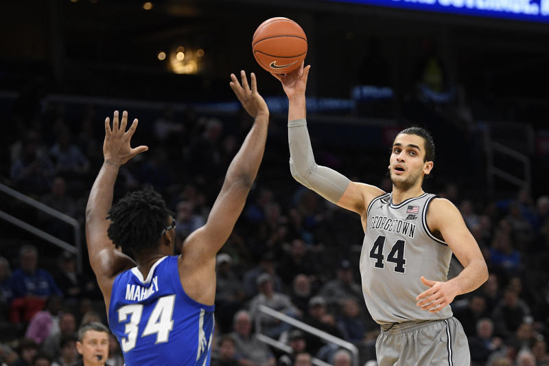 Georgetown center Omer Yurtseven (44) handles the ball next to Creighton guard Denzel Mahoney (34) during the second half of an NCAA college basketball game, Wednesday, Jan. 15, 2020, in Washington. Georgetown won 83-80. (AP Photo/Nick Wass)