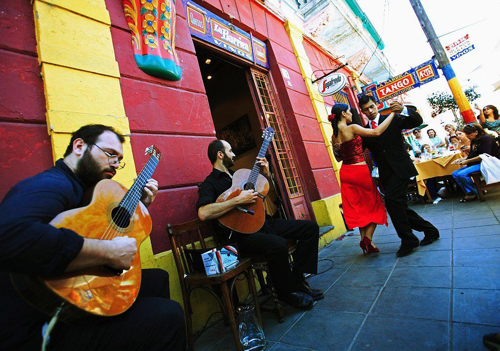 A couple dances the traditional dance Tango in front of a restaurant in La Boca district in Buenos Aires, Argentina.