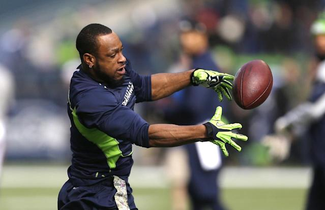 Seattle Seahawks' Percy Harvin reaches for a ball as he warms-up on the field before an NFL football game against the Minnesota Vikings, Sunday, Nov. 17, 2013, in Seattle. (AP Photo/Ted S. Warren)