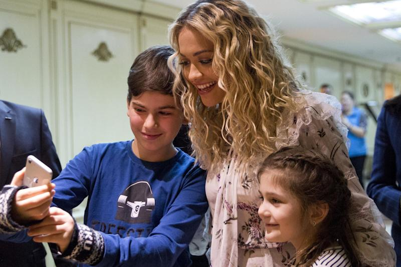 Kosovo born British singer Rita Ora poses for a photograph with young fans in Pristina: AP