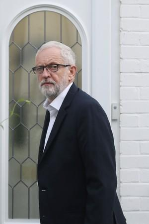 Britain's opposition Labour Party leader Corbyn leaves his home in London
