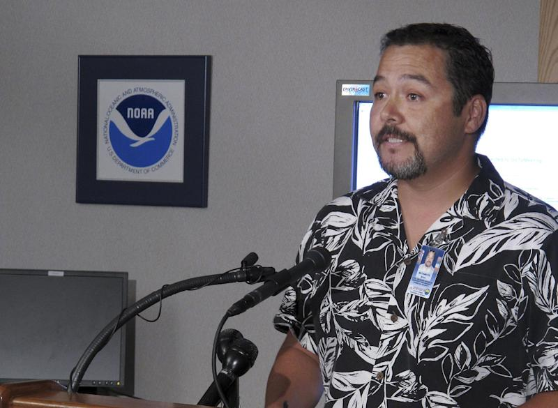 Brian Miyamoto, spokesman for Hawaii State Civil Defense, speaks about preparations for Tropical Storm Flossie during a news conference in Honolulu on Monday, July 29, 2013. A tropical storm making its way toward Hawaii had residents of Maui and the Big Island on Monday bracing for possible flooding, 60 mph wind gusts and waves that could reach as high as 18 feet. Tropical Storm Flossie could also bring mudslides, tornadoes and waterspouts, forecasters said. (AP Photo/Oskar Garcia)