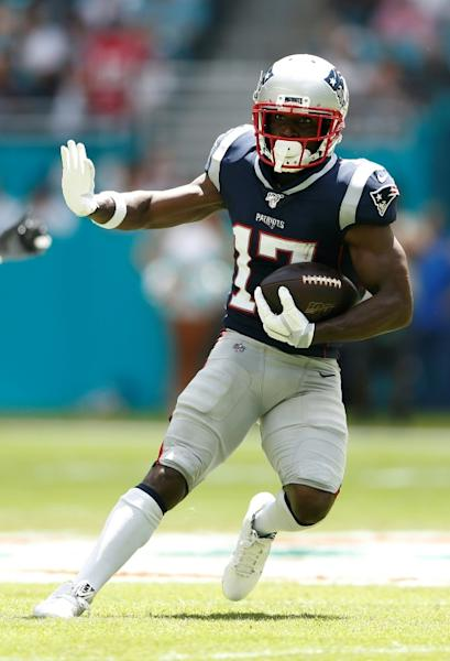 New England Patriots receiver Antonio Brown runs with the ball after catching a pass from Tom Brady in last weekend's victory over Miami (AFP Photo/Michael Reaves)