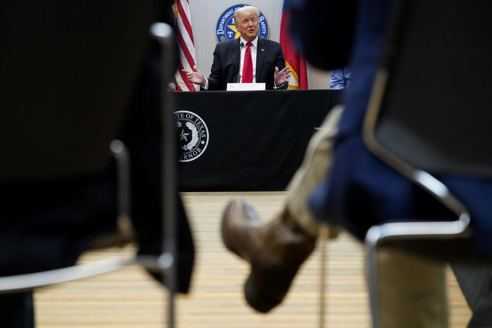 Former President Donald Trump attends a security briefing with Texas Governor Greg Abbott and state officials and law enforcement at the Weslaco Department of Public Safety DPS Headquarters before touring the US-Mexico border wall on Wednesday, June 30, 2021 in Weslaco, Texas. Trump was invited to South Texas by Abbott, who has taken up Trump's immigration mantle by vowing to continue building the border wall.(Jabin Botsford/The Washington Post via AP, Pool)
