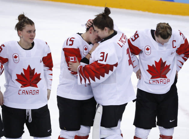 Team Canada players react after losing the women's hockey gold medal game against the U.S. at the Winter Olympics in South Korea on Feb. 22, 2018.