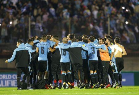 Soccer Football - 2018 World Cup Qualifiers - Uruguay v Bolivia - Centenario stadium, Montevideo, Uruguay - October 10, 2017. Uruguay's National soccer team players celebrate after qualifying to the World Cup finals. REUTERS/Andres Stapff