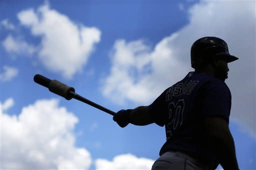 Colorado Rockies' Wilin Rosario warms up before an at-bat in the first inning of the first game of a baseball doubleheader against the Philadelphia Phillies, Sunday, Sept. 9, 2012, in Philadelphia. (AP Photo/Matt Slocum)