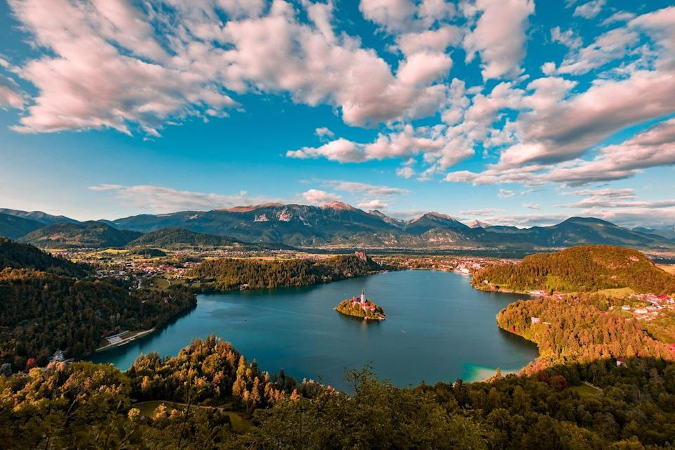 """<p><a href=""""https://www.gov.uk/foreign-travel-advice/slovenia/entry-requirements"""" rel=""""nofollow noopener"""" target=""""_blank"""" data-ylk=""""slk:Entry requirements and travel advice for Slovenia"""" class=""""link rapid-noclick-resp"""">Entry requirements and travel advice for Slovenia</a> </p><p>For sparkling lakes and mountain walks, look no further than picturesque Slovenia, home to the magical Lake Bled and its island. The small country bordered by Italy, Austria, Croatia and Hungary is ideal for exploring Europe's natural beauty, as you discover the Julian Alps, the only national park in Slovenia and one of the most captivating caves in the world. See Slovenia by train and coach over 10 days in September on a relaxing escape.</p><p><strong>Good Housekeeping's 10-day Slovenia rail tour departs on 19th September.</strong></p><p><a class=""""link rapid-noclick-resp"""" href=""""https://www.goodhousekeepingholidays.com/tours/lake-bled-slovenia-munich-walking-tour"""" rel=""""nofollow noopener"""" target=""""_blank"""" data-ylk=""""slk:FIND OUT MORE"""">FIND OUT MORE</a></p>"""