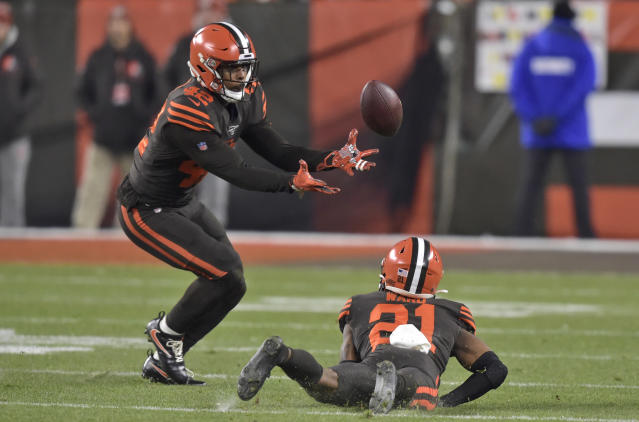 Cleveland Browns strong safety Morgan Burnett (42) catches an interception during the first half of the team's NFL football game against the Pittsburgh Steelers, Thursday, Nov. 14, 2019, in Cleveland. (AP Photo/David Richard)