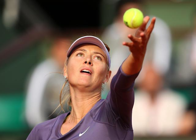 PARIS, FRANCE - JUNE 03: Maria Sharapova of Russia serves in her Women's Singles match against Sloane Stephens of United States of America during day nine of the French Open at Roland Garros on June 3, 2013 in Paris, France. (Photo by Julian Finney/Getty Images)