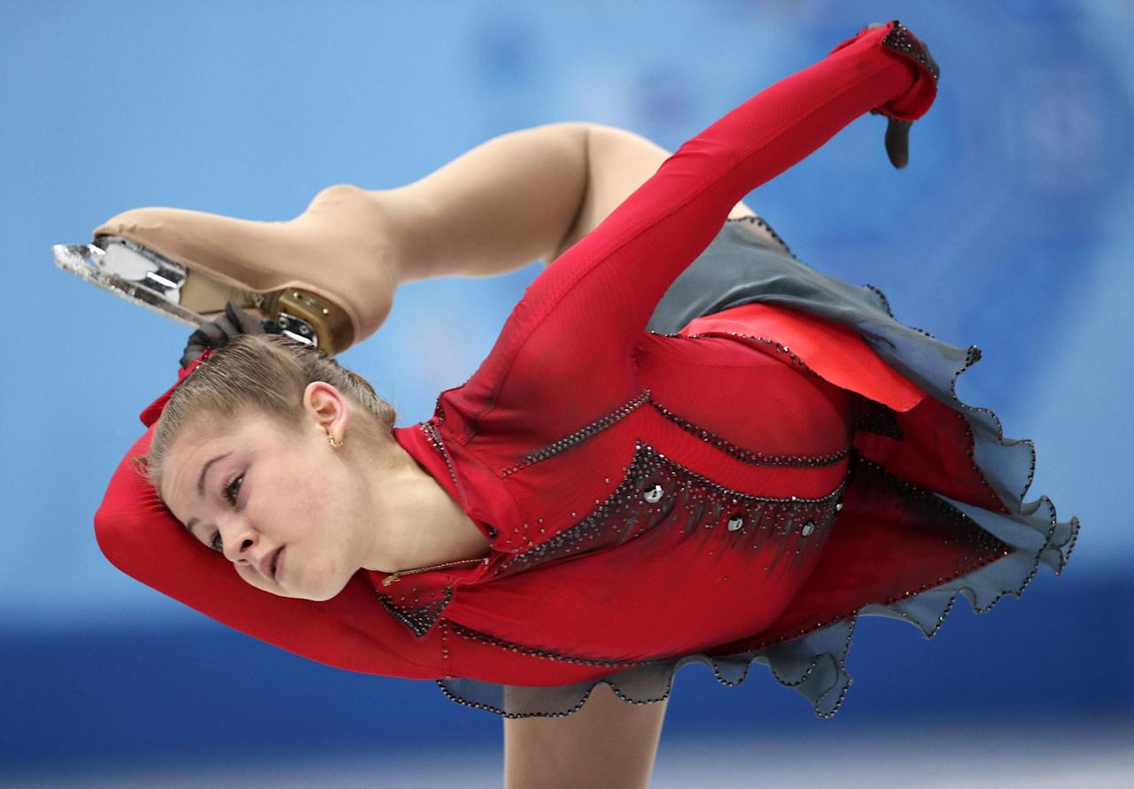 Julia Lipnitskaia of Russia competes in the women's team free skate figure skating competition at the Iceberg Skating Palace during the 2014 Winter Olympics, Sunday, Feb. 9, 2014, in Sochi, Russia. (AP Photo/Bernat Armangue)