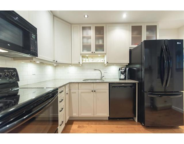 """<p><a href=""""https://www.zoocasa.com/vancouver-bc-real-estate/5054126-p4-1345-w-15th-avenue-vancouver-bc-v6h1s2-r2234765"""" rel=""""nofollow noopener"""" target=""""_blank"""" data-ylk=""""slk:4 1345 West 15th Avenue, Vancouver, B.C."""" class=""""link rapid-noclick-resp"""">4 1345 West 15th Avenue, Vancouver, B.C.</a><br> The kitchen connects to the cozy dining room.<br> (Photo: Zoocasa) </p>"""