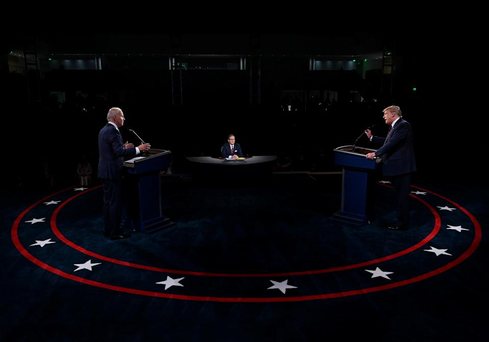U.S. President Donald Trump and Democratic presidential candidate, former Vice President Joe Biden participate in the first presidential debate at Case Western University and Cleveland Clinic, in Cleveland, Ohio, U.S., September 29, 2020. Picture taken September 29, 2020. Olivier Douliery/Pool via REUTERS